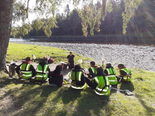 River Dee Trust education officer Jane Lilley is teaching children about the River Dee Provided by River Dee Trust