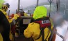 Lifeboat crews from Oban battle waves on their way to aid a fishing boat on Loch Etive.