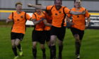 Paul Macleod, centre, celebrates his winning goal for Rothes in the Highland League Cup final. Pictures by Kenny Elrick