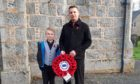 Councillor Robbie Withey and his son Shea at last year's Remembrance Sunday event in Tullynessle.