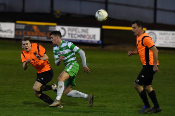 Rothes midfielder Fraser Robertson, left, in action against Buckie during the Highland League Cup final