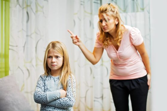 Picture shows a mother and daughter having quarrel at home.