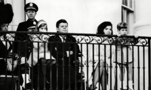 President Kennedy and his family enjoy The Black Watch performance.