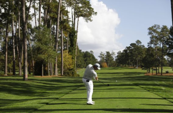 Bryson DeChambeau of the US hits his tee shot on the seventeenth hole during the first practice round of the 2020 Masters Tournament at the Augusta National Golf Club in Augusta, Georgia, USA.