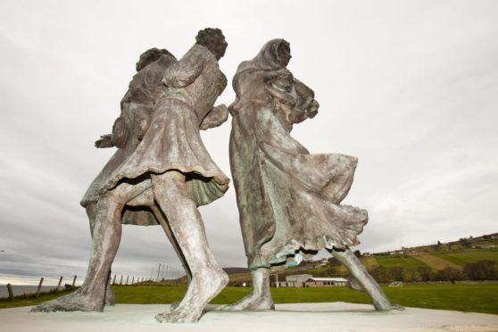 The Emigrants Statue in Helmsdale commemorates the flight of Highlanders during the highland clearances, and celebrates their accomplishments in the places they settled (Photo by Global Warming Images/Shutterstock)