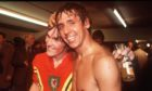 Don Masson and Kenny Dalglish celebrate after victory against Wales in 1977.