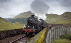 The Jacobite Steam Train crosses the Glenfinnan Viaduct on its way from Fort William to Mallaig.