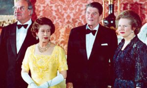 Queen Elizabeth II, West German Chancellor Helmut Kohl, US President Ronald Reagan and Prime Minister Margaret Thatcher at Buckingham Palace, prior to a dinner for summit leaders,1984 Photo by AP/Shutterstock
