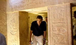US President Barack Obama ducks his head to get through an entranceway on a tour of the Pyramids and Sphinx in Egypt. On the centre-right of the picture is the hieroglyphic that the President commented on saying it looked like him. Photo by Shutterstock, June 2009