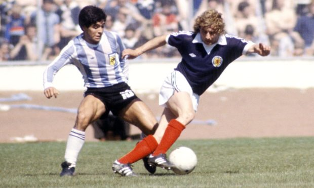 Maradona tackles Asa Hartford at Hampden in 1979.