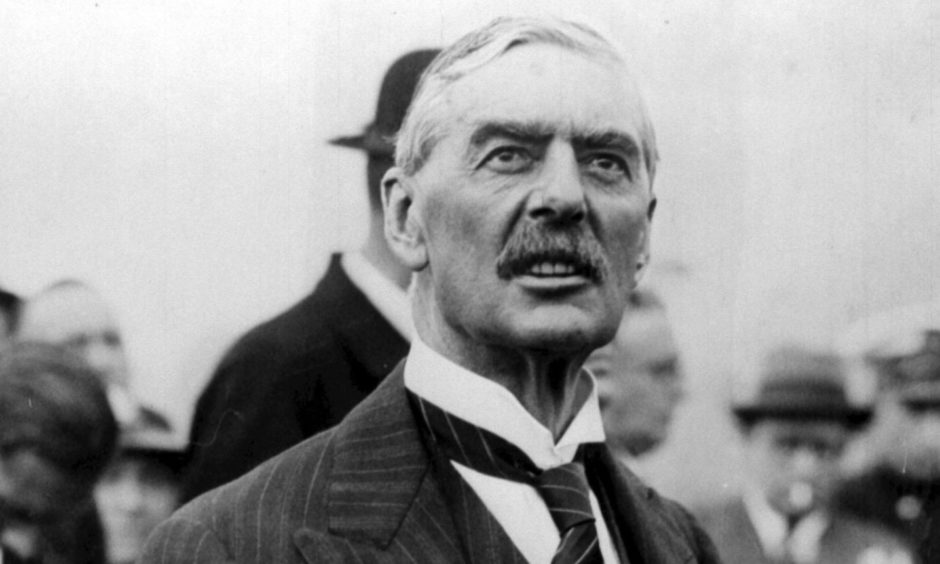 Neville Chamberlain struggles to keep up with events at Holyrood on Wednesday.