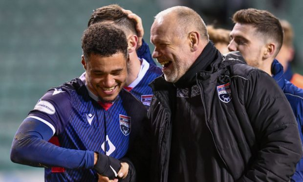 Ross County manager John Hughes with winger Jermaine Hylton.