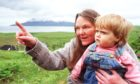 Secretary of the Isle of Eigg Heritage Trust Maggie Fyffe with the island's youngest resident Kirsty Ann Robertson, 15 months