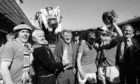 Tommy Docherty, seen here winning the FA Cup in May 1977.