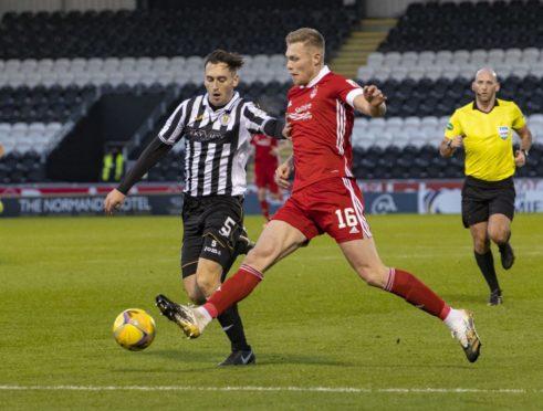 Aberdeen's Sam Cosgrove and St Mirren's Connor McCarthy in action
