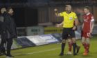 Referee Bobby Madden shows Aberdeen manager Derek McInnes a yellow card and Jonathan Hayes looks frustrated during the Scottish Premiership match between St Mirren and Aberdeen.