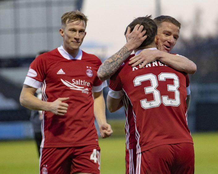 Aberdeen's Ross McCrorie, Jonny Hayes and Matty Kennedy celebrate the first goal during the Scottish Premiership match between St Mirren and Aberdeen at the SMISA Stadium on December 5, 2020, in Paisley, Scotland.