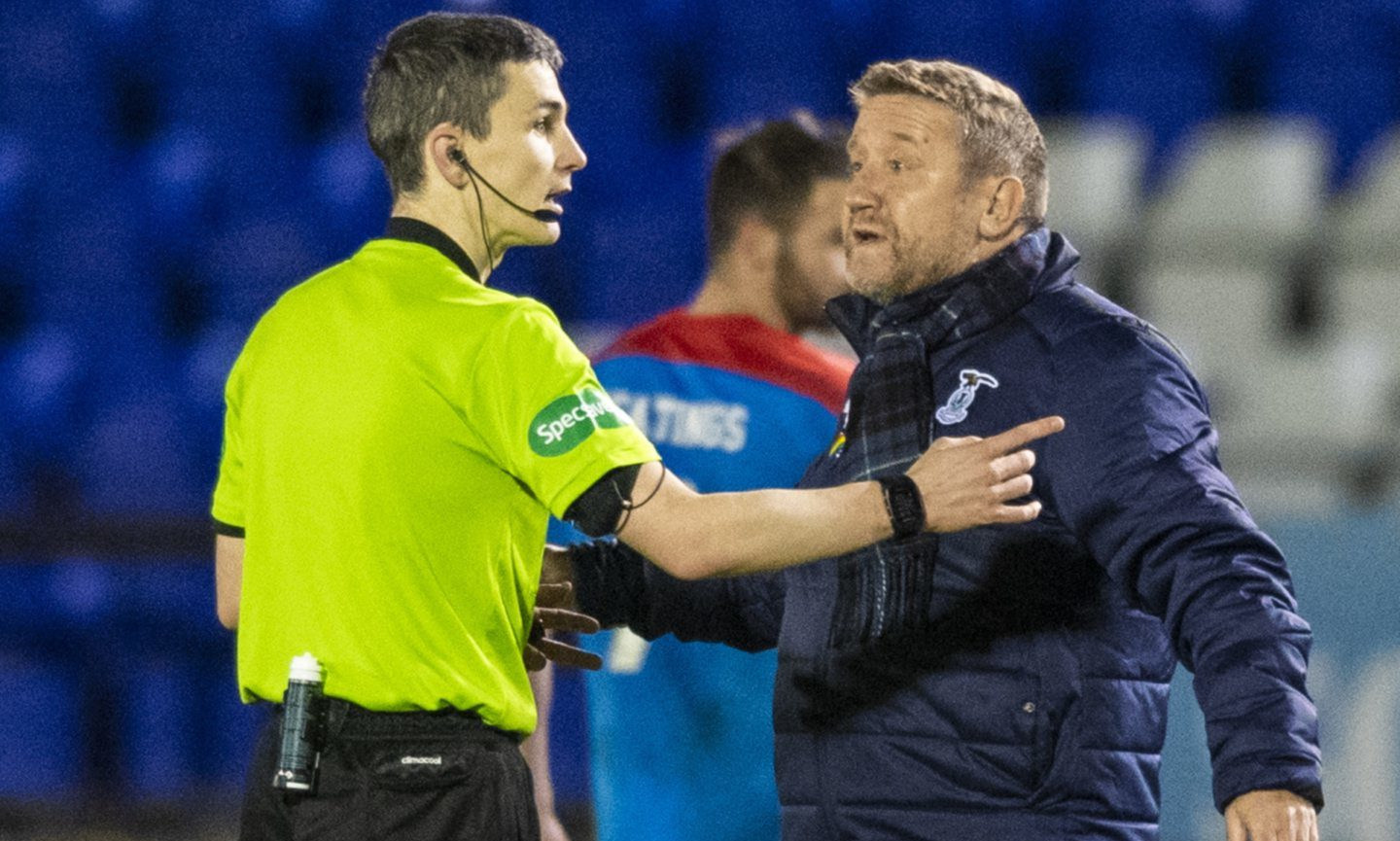 Inverness manager John Robertson shows his frustration at full-time.