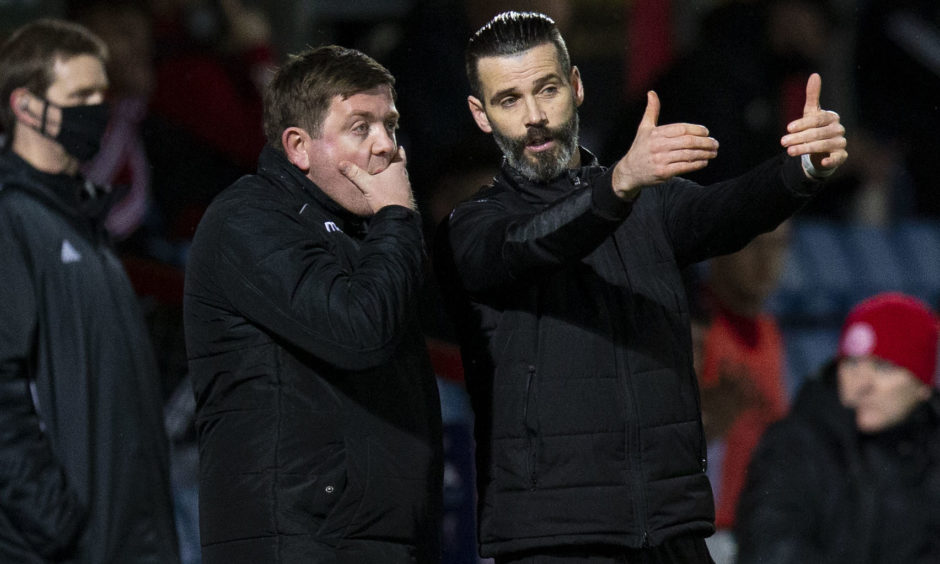 Stuart Kettlewell (R) and assistant Richard Brittain during the Premiership match between Ross County and Hamilton at the Global Energy Arena this afternoon.