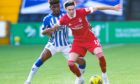 Ryan Hedges holds off Aaron Tshibola.