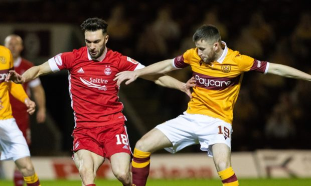 Connor McLennan in action against Motherwell midfielder Liam Polworth.