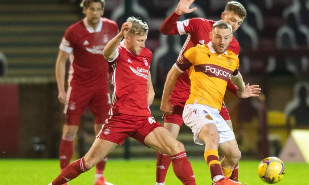 Aberdeen's Ross McCrorie challenges Allan Campbell of Motherwell.