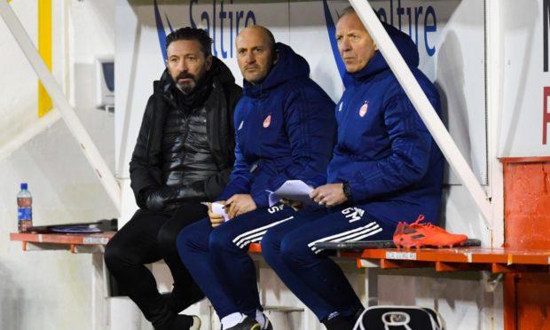 Aberdeen manager Derek McInnes, coach Paul Sheerin and goalkeeping coach Gordon Marshall during the Scottish Premiership match between Aberdeen and St Johnstone.