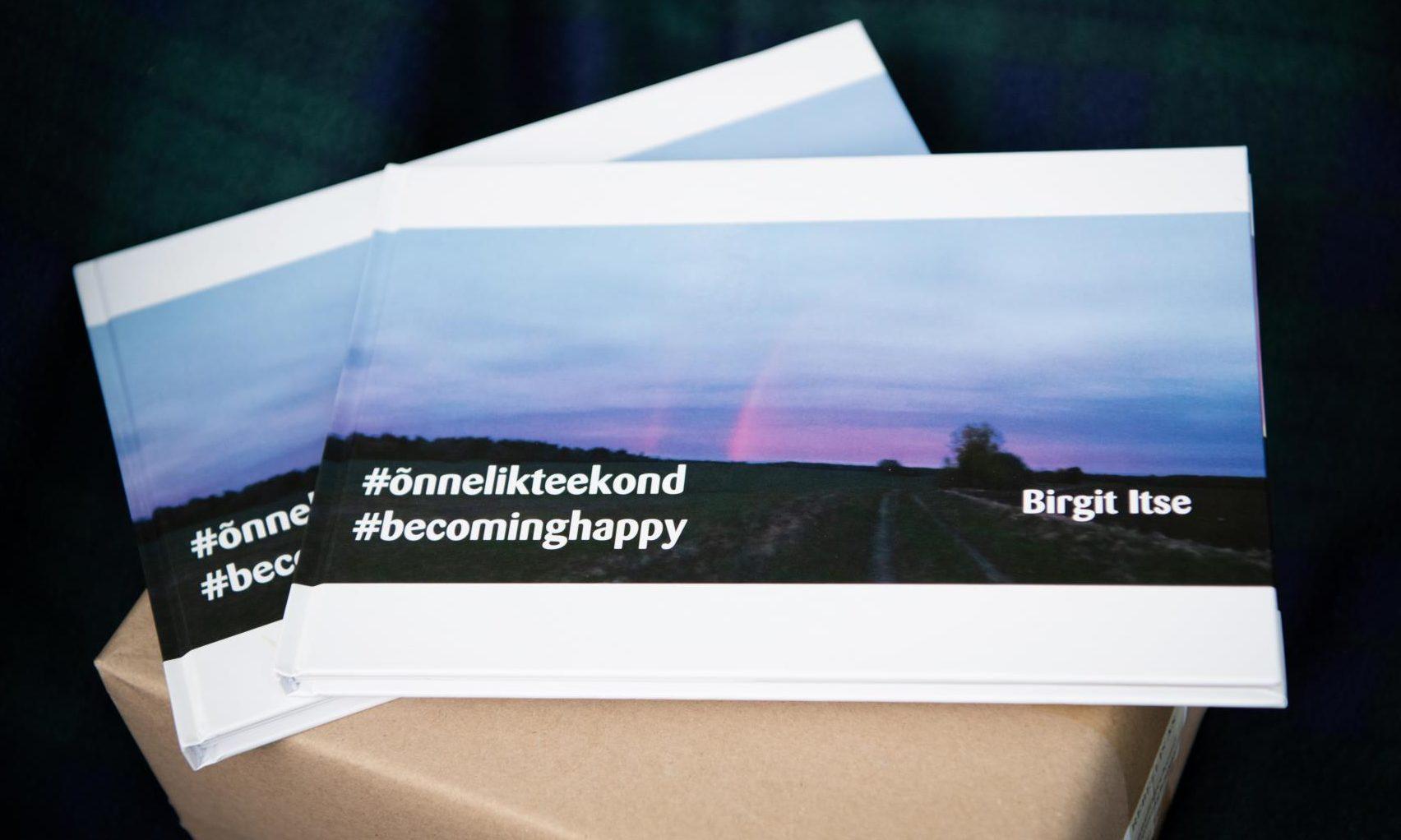 Copies of #õnnelikteekond #becominghappy by Aberdeen author Birgit Itse.