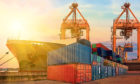 Container ship in export and import business and logistics