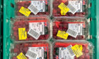Raspberries reduced in price in a shop to avoid food going to waste.