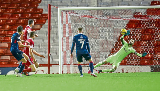 Aberdeen goalkeeper and captain Joe Lewis saves a shot from Ross County's Ross Stewart during Saturday's Premiership meeting.