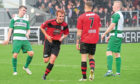 Martin Laing celebrates a goal for Locos in 2017.