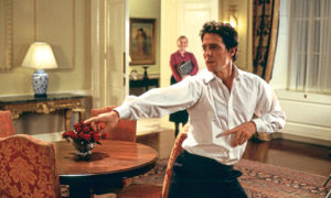 STRUTTING HIS STUFF: Hugh Grant​ dances round Number 10 Downing Street in Love, Actually, a film that is now a Christmas staple.