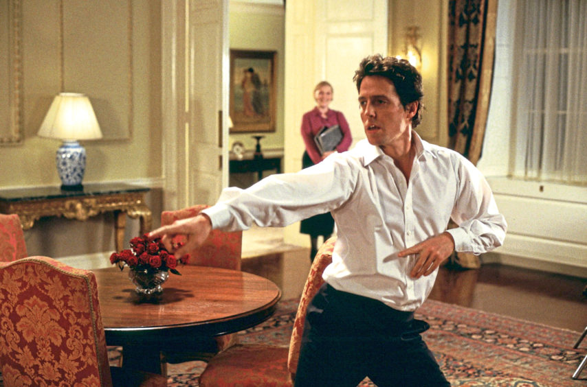 STRUTTING HIS STUFF: Hugh Grant dances round Number 10 Downing Street in Love, Actually, a film that is now a Christmas staple.