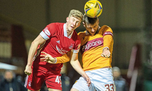 Ross McCrorie, left, challenges for a header for Aberdeen.