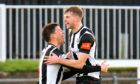 Aiden Sopel (right) celebrates scoring for Elgin City