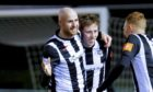 Kane Hester, centre, celebrates netting for Elgin City.