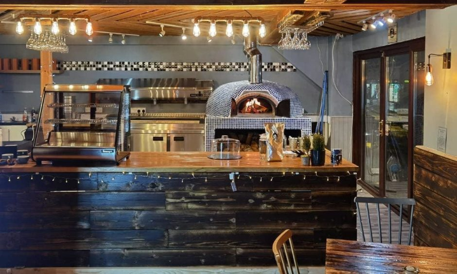 The restaurant's new interior, including pizza oven.
