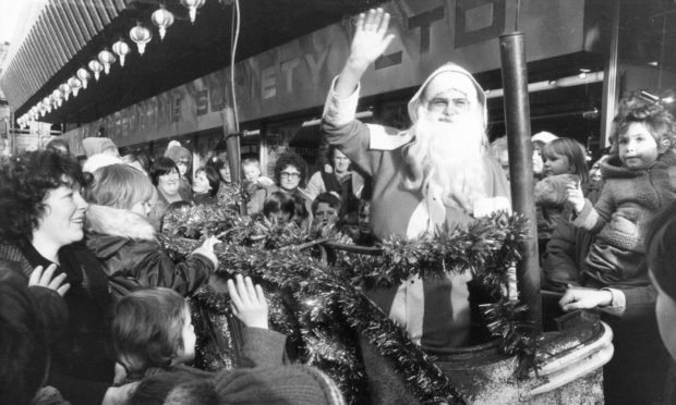 Santa arriving by rocket at Aberdeen's Norco House in 1981.
