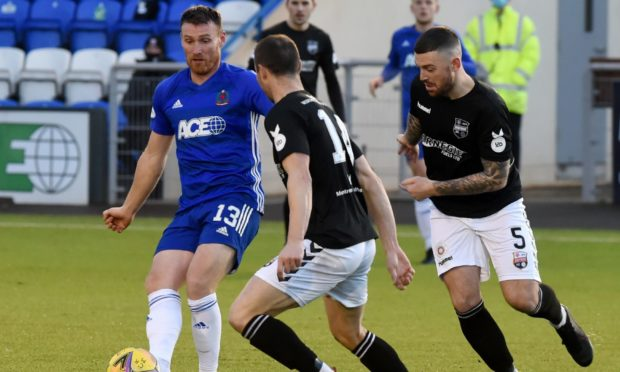 Cove Rangers striker Rory McAllister in action against Montrose.