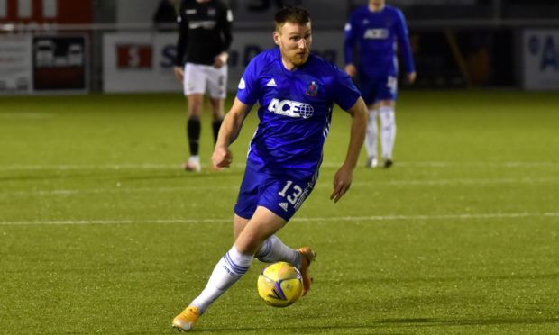 Rory McAllister in action for Cove Rangers.