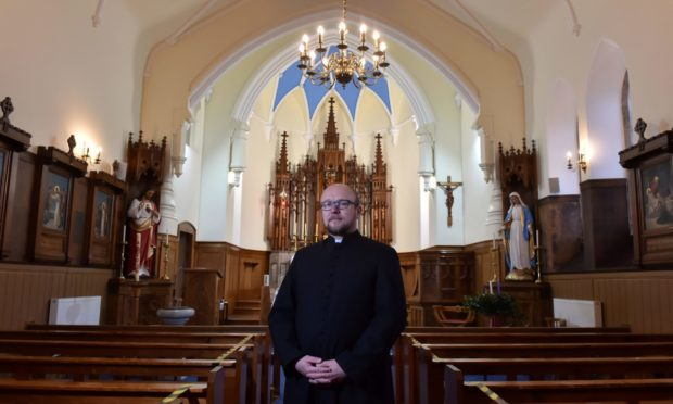 Father Piotr Rytel at the revamped Our Lady of Mount Carmel Roman Catholic Church, Banff.