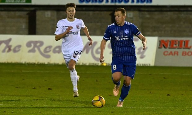 Scott Brown, right, in action for Peterhead prior to the shutdown of lower league football.