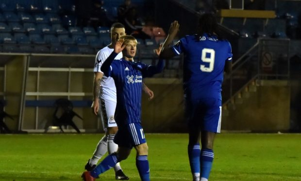 Lyall Cameron, left, during the game against Montrose with Peterhead goalscorer Isaac Layne