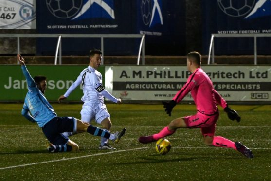Mitch Megginson scores the winner for Cove Rangers at Forfar.