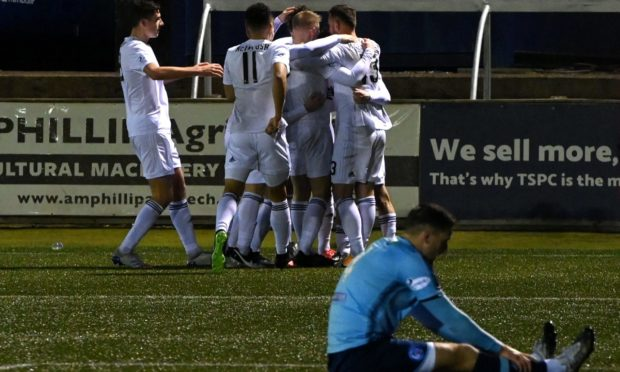 Mitch Megginson celebrating with his Cove teammates after scoring.  Picture by Kenny Elrick