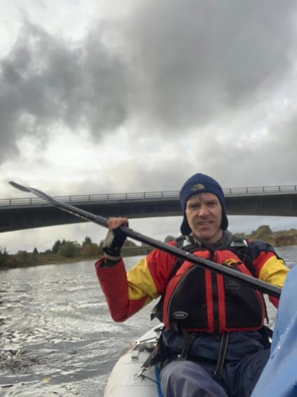 Mr Stutter canoeing in the lower reaches of the Dee.