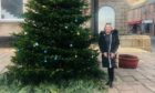 Dianne Beagrie beside the Christmas tree with its new decorations.