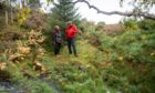 Eleanor Garty from  Woodland Trust Scotland at Delbog croft near Nethy Bridge with crofter Graeme Pringle