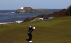 Scotland's Stephen Gallacher plays into the thirteenth green during the second round of the 2020 Aberdeen Standard Investments Scottish Open at The Renaissance Club, North Berwick.